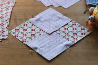 pin two squares onto 5 1/4 inch block