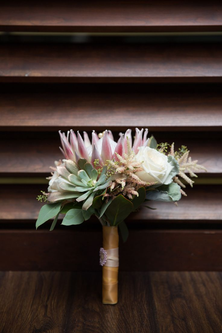 King protea, garden roses, succulents, astilbe and seeded eucalyptus