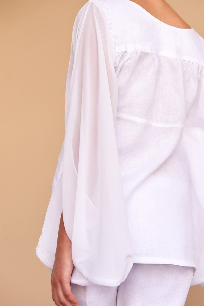 a1d53d9a849b8b This gorgeous bat-winged white linen blouse is the perfect addition to any  ensemble for