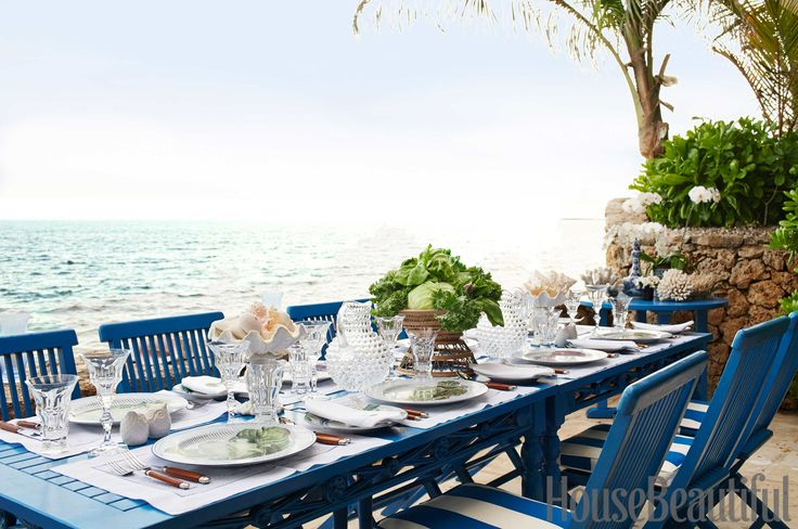 For a table by Jackie and Rebecca De Ravenel, a palette of crisp blue and white paired with colorless glassware makes for a perfect scene on warmer days. Try it at home: Set your table (indoors or out) with a blue-and-white tablecloth and use classic glassware.   - HouseBeautiful.com