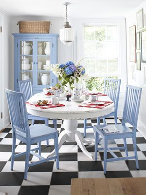 Great idea: Add a pop of color to an otherwise neutral space with painted furniture, bright table settings, and -- when spring finally comes! -- pretty cut flowers.     #kitchen #decorating #color: Dining Rooms, Decor Ideas, Beaches House Decor, Floors, Color, Blue Chairs, Dining Nooks, Dining Tables, Boards
