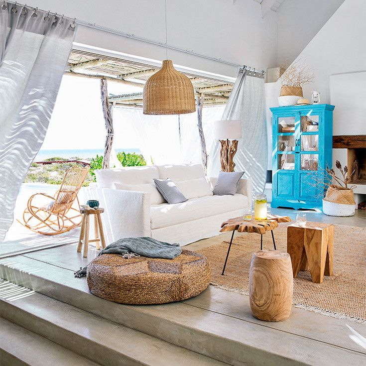 Beachy decor with rustic natural accents and a pop of turquoise! Love the raw woods and woven pendant lights