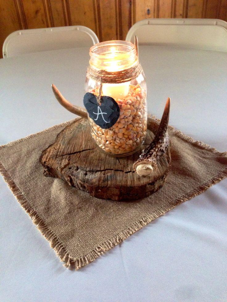 Wedding centerpiece. Rustic barn country wedding. Mason jar with corn and deer antler.