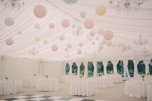 Pastel decoration and chandelier in your wedding marquee