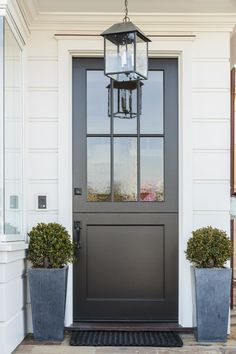 black exterior door with white millwork.