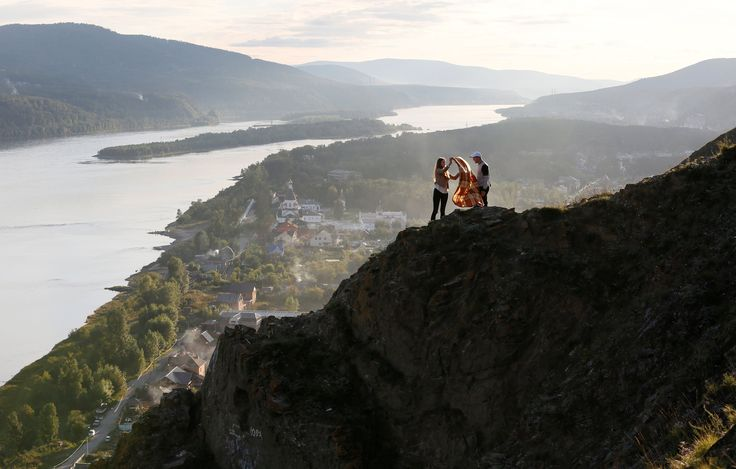 Best photographs of the day: a glass bridge and redheads in Ireland-asnoyarsk, Russia  A couple spread a blanket on a rocky hillside near the Yenisei river in Siberia Photograph: Ilya Naymushin/Reuters  Facebook Twitter Pinterest