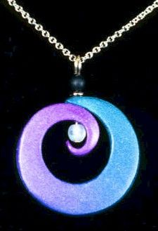 Polymer clay pendant swirled to showcase a glass bead drop