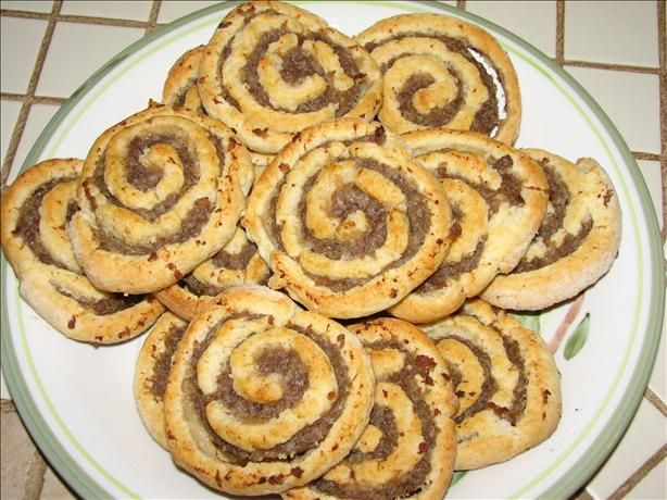 Sausage Pinwheels from Food.com:   								Another recipe from my Grandma. These are always a big hit at our family functions. Very easy to make, but so so good!