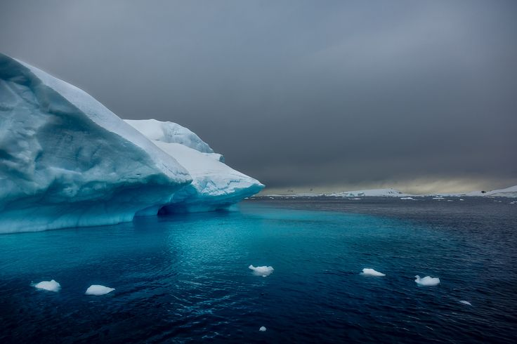 Light illuminates ice off the coast of Cuverville Island in Antarctica.