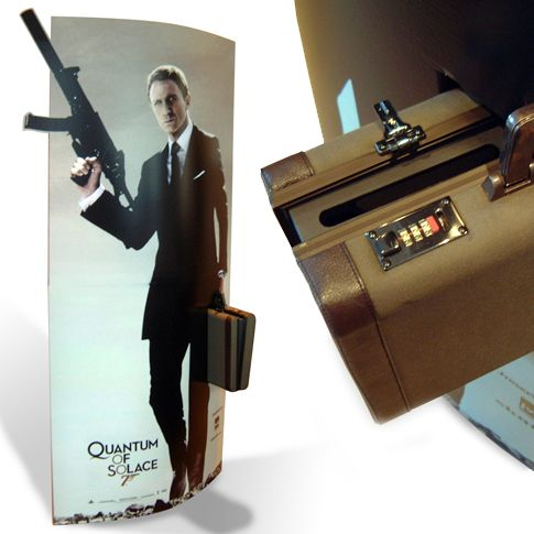 James Bond elipse standee with built-in real-life suitcase. The suitcase has an insert for coupons.