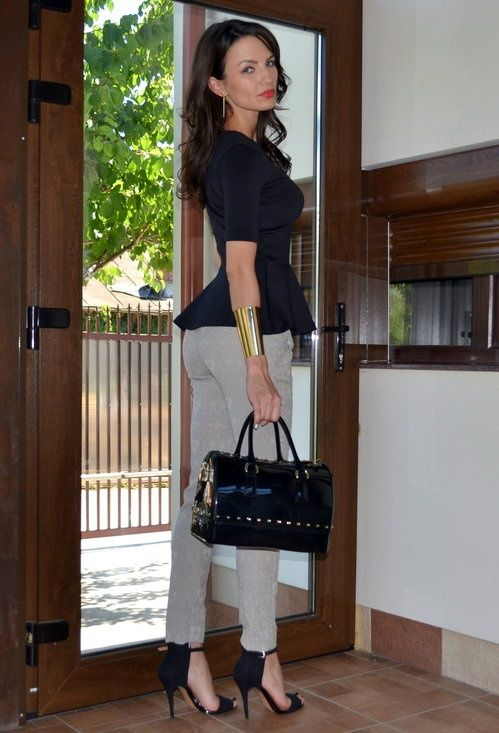Black peplum top, grey pants, black heels and bag, gold bracelet