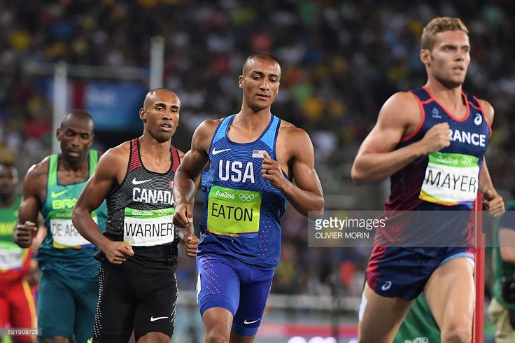 France's Kevin Mayer, USA's Ashton Eaton and Canada's Damian Warner compete in the Men's Decathlon 1500m during the athletics event at the Rio 2016 Olympic Games at the Olympic Stadium in Rio de Janeiro on August 18, 2016. / AFP / OLIVIER