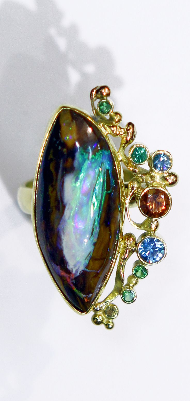 Boulder Opal ring with brown zircon, emerald, tsavorite & topaz in 22k and 18k gold.  Designed by Jennifer Kalled.  Boulder opal from Bill Kasso. www.kalledjewelrystudio.com