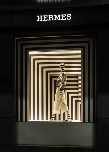 Recursive black and white stripes highlight the in this Hermes window  display - Sydney, Australia