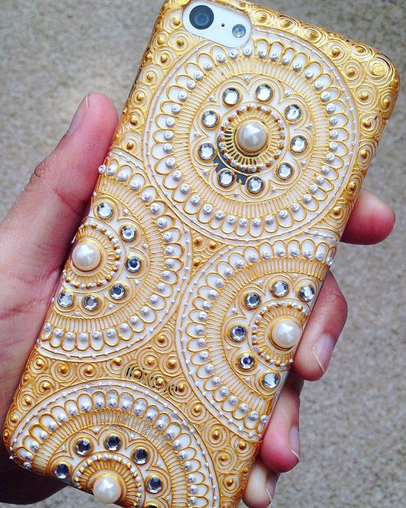 Hand made Henna patterned phone case on a clear hard back case. Available for all phones and with different coloured stones as shown in the pictures.