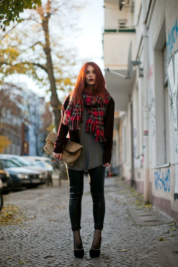 Masha Sedgwick on a street style photo in Berlin wearing autumnal colors and leather pants