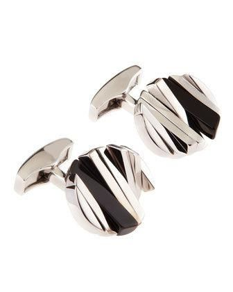 Silver plating. Silver and onyx rotating bars form circle disks. Imported. More Details