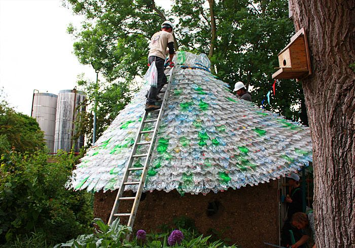 Fizzy Bottle Hut! At first glance, the recycled structure might look like it has a colorful, shingled roof but upon closer inspection, you can see that it's actually made up of thousands of flattened soda and water bottles. http://inhabitat.com/fizzy-bottle-roof-made-from-7000-plastic-bottles/