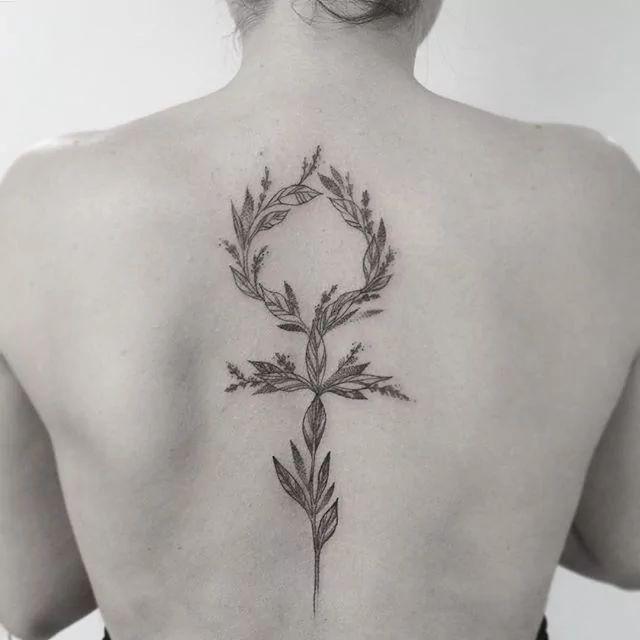 Botanical floral Venus symbol tattoo by Gabriela Arzabe Lehmkuhl.