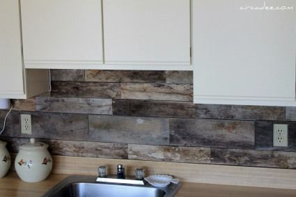 pallet wood back splash.  Totally cheap and good.  Intermittent makeover.