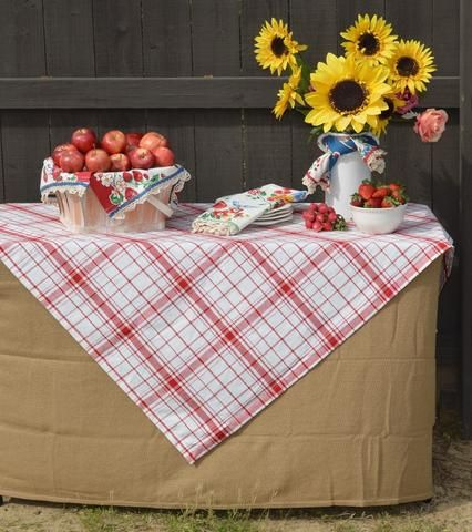 Down Home Plaid Tablecloth layered with a simple rustic burlap tablecloth. Vintage style fruity tea towels add to the country charm. A perfect look for a rustic wedding or outdoor buffet table.