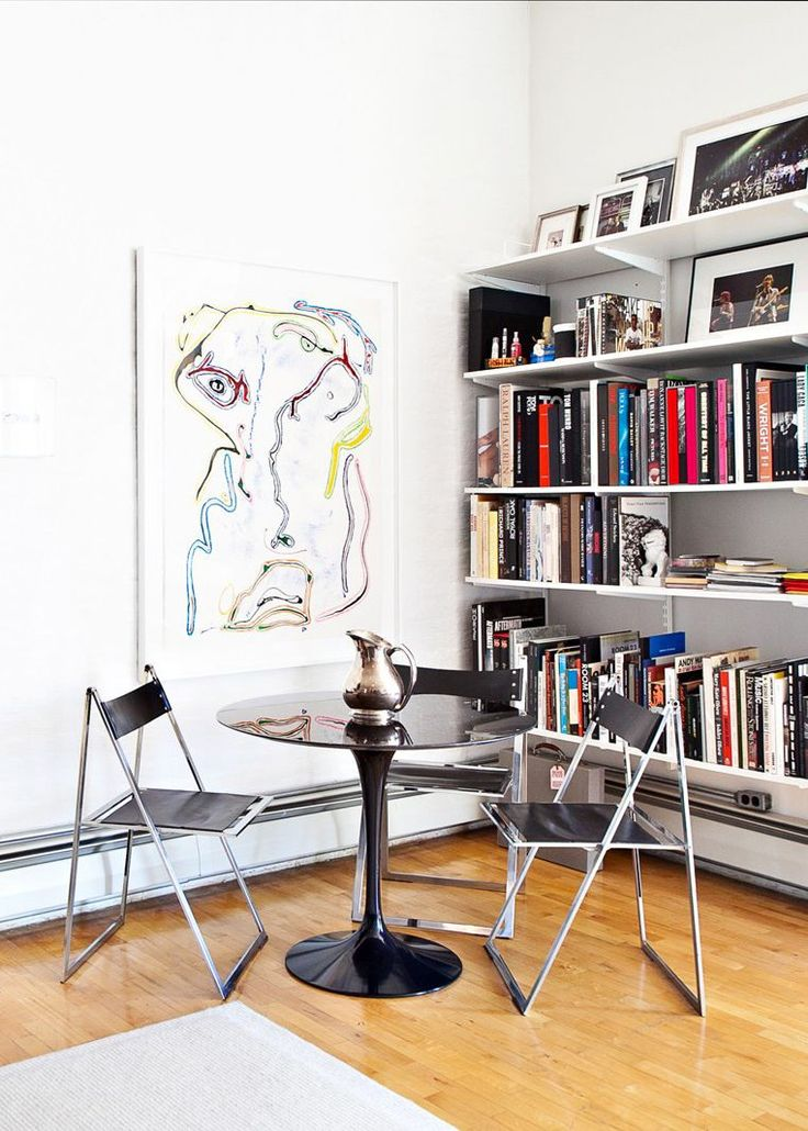 50 Ideas To Make Your Tiny Apartment So Next Level #refinery29  http://www.refinery29.com/small-space-living#slide-33  Squeeze a table and folding chairs in next to your bookcase for a dining nook that delivers on style and smarts....