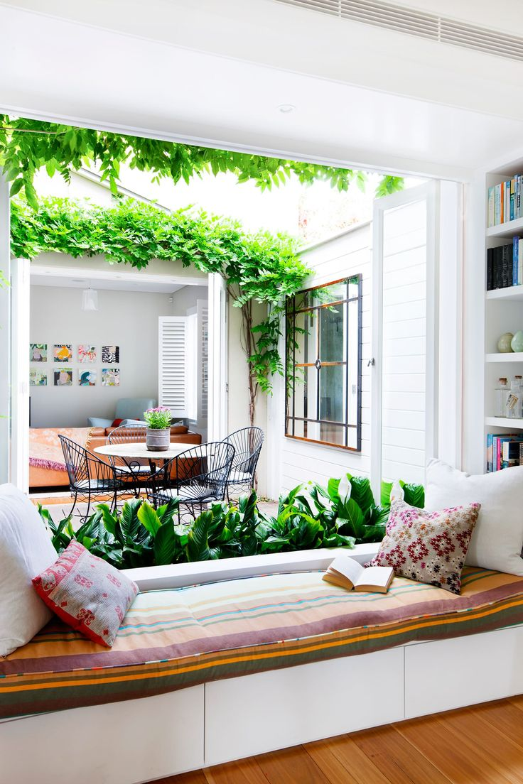 Reading nook overlooking bright inner courtyard