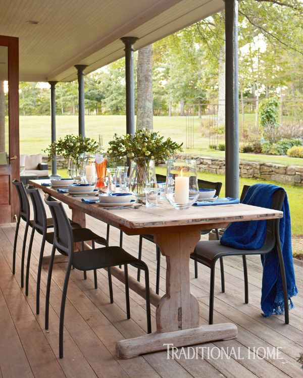 An antique Irish refectory table is set for guests on this lovely porch. - Photo: Michael Partenio