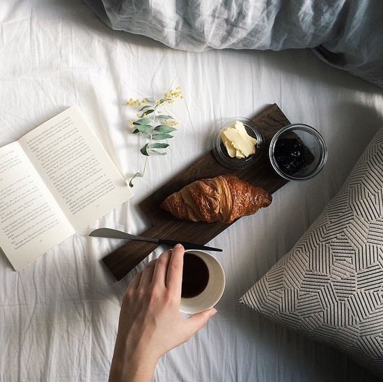 Read a book, eat a croissant, drink some coffee and get up from your bed