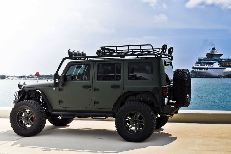 Military Green Jeep Wrangler along with a German Shepherd inside ;)
