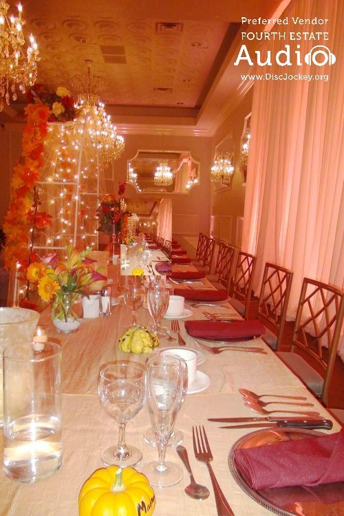 Festive autumn pumpkins accent the decor on the wedding party's head table at Drury Lane.