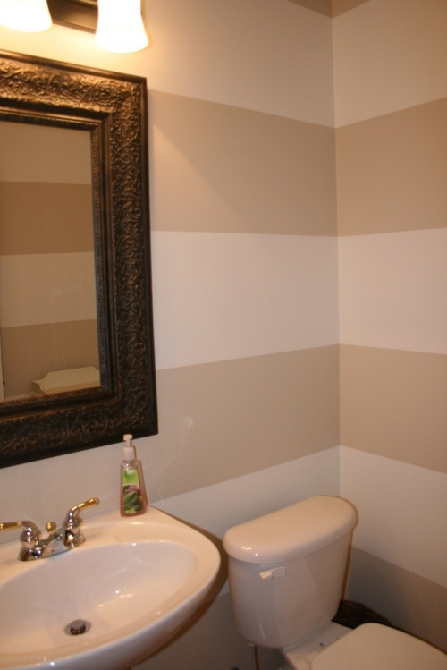 Good idea for a small bathroom - the horizontal stripes make the room seem larger... http://www.bathroom-paint.net/guest-bathroom-paint.php