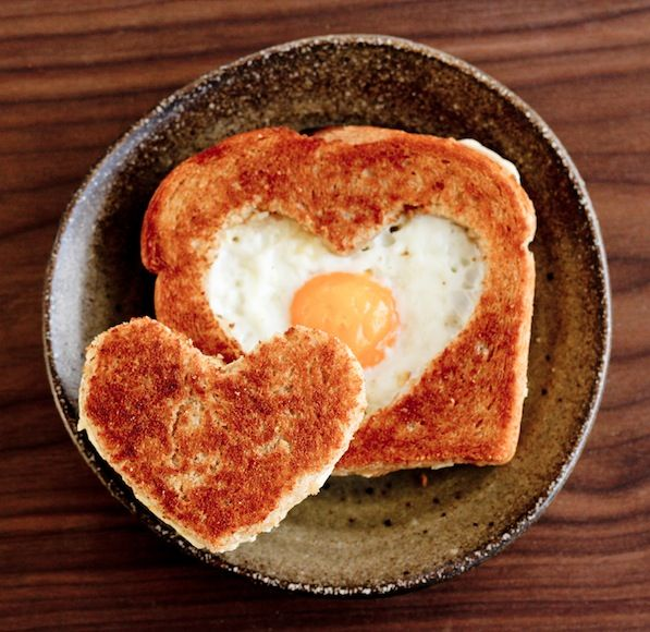 Have always wanted to make an egg in the basket. Love the heart shape addition :)
