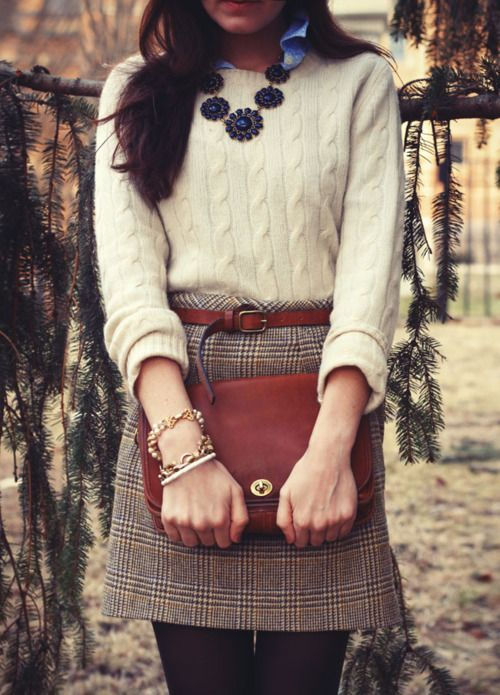 Light blue button up, cream chunky knit sweater, neutral plaid mini skirt, wine belt, wine large clutch, gold bracelets, dark tights