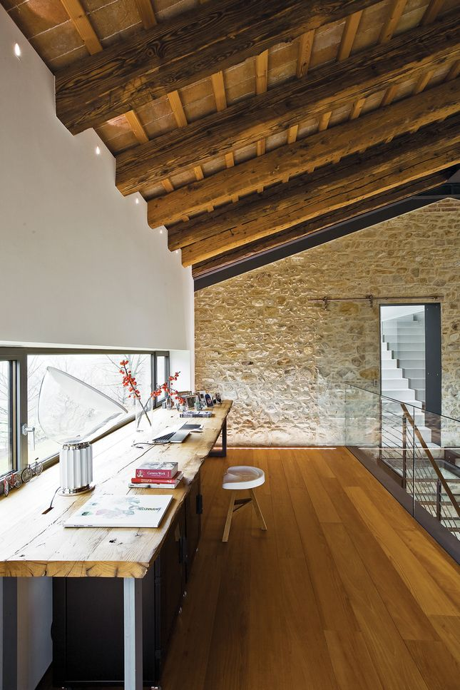 Chiavelli residence in Northern Italy.  Showing the second floor office area.  In Dwell.com.  Look at those beams and that floor.  And the stone wall.  And the table.  And the glass railing.  Wow.  I'd take it all.