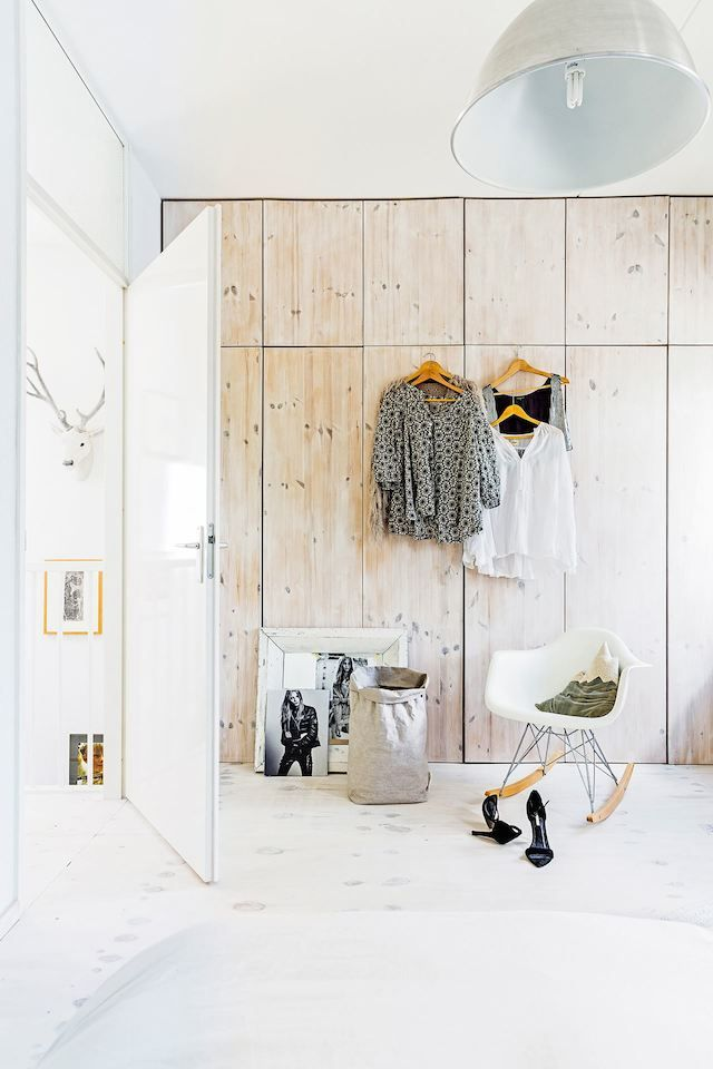 Bespoke floor to ceiling wardrobe in wood in the fuss-free and laid back Dutch home of Marieke Rusticus.