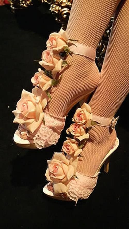 Omg I am in lobe with these shoes I love the way the roses goes down I would like were these at like a after party or mabey at a wedding and I also like the lase on it it is very pretty