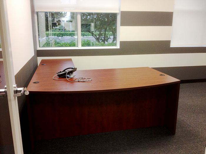 traditional and functional office furniture pieces were used to fill the space with all essentials