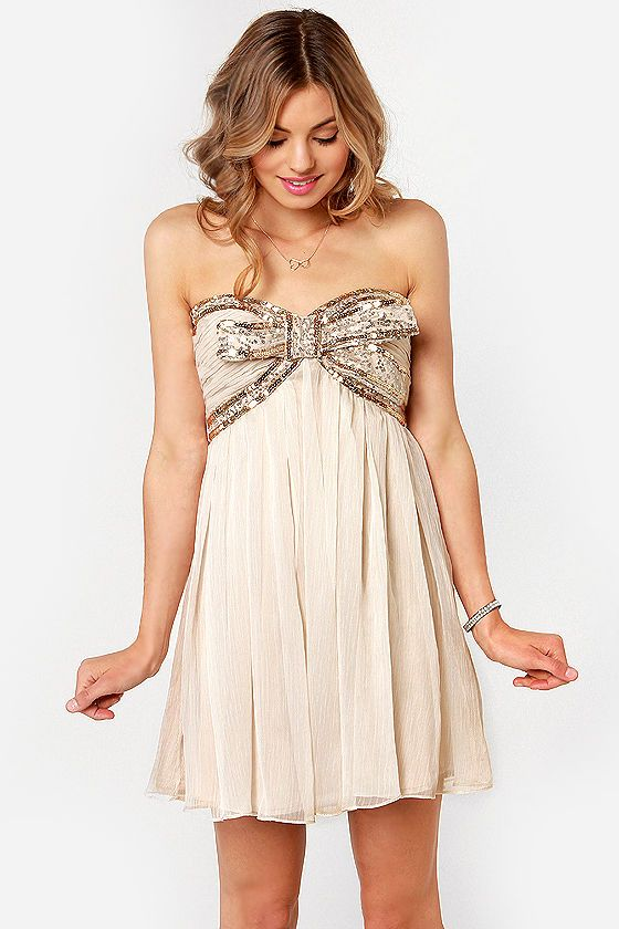 Omg I love this dress!  The Whole Package Strapless Beige Sequin Dress at LuLus.com!