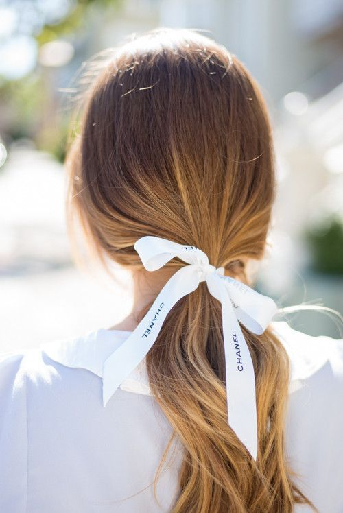 Styling your hair with a chanel bow on a style album