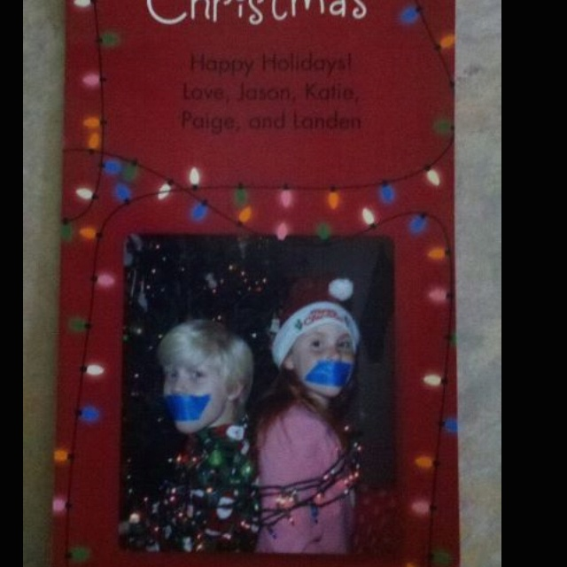 Cute Christmas card idea. Put the kids in their holiday Jammie's sitting back to back, wrap them up in Christmas lights, and duck tape their mouths! All I had was blue but a red or green tape would be better! Then I uploaded it to Walmart.com and an hour later I had 60 Christmas cards!