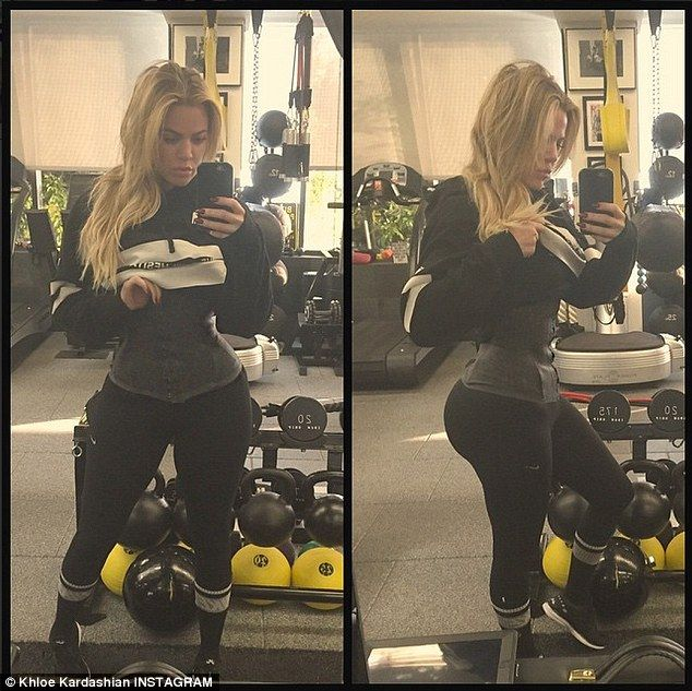 Sucking it in:Khloe Kardashian posted a picture of herself working out in a waist trainer...