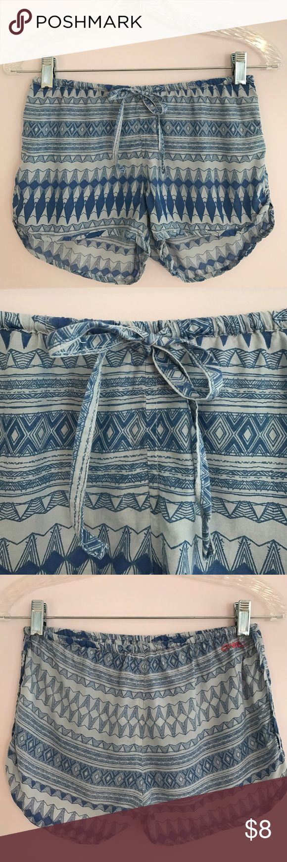 O'NEILL SOFT BLUE TRIBAL SHORTS Super cute and comfortable beachy shorts! Cute over a bikini or with a white top out on the town. Run a bit small but are very cute and somewhat stretchy! O'Neill Shorts