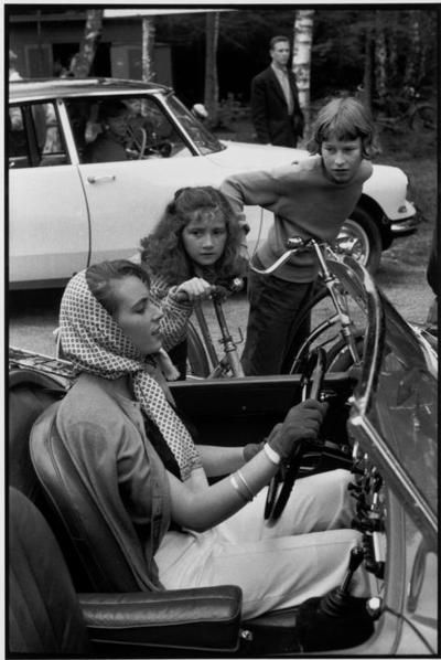 Henri Cartier-Bresson, SWEDEN. Tylösand. 1956.This is interesting because in 1956 Sweden still drove on the left and didn't switch sides until1967. So why do the cars in the photo have the steering wheel on the left? However I checked and apparently most Swedes were driving LHD cars presumably because they were imported from nearby countries .