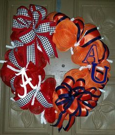 "This is a 24"" hand crafted Alabama/Auburn house divided deco mesh wreath. One side is made of orange, blue and white mesh with orange and blue accenting ribbon and a hand painted A and U letters. The"