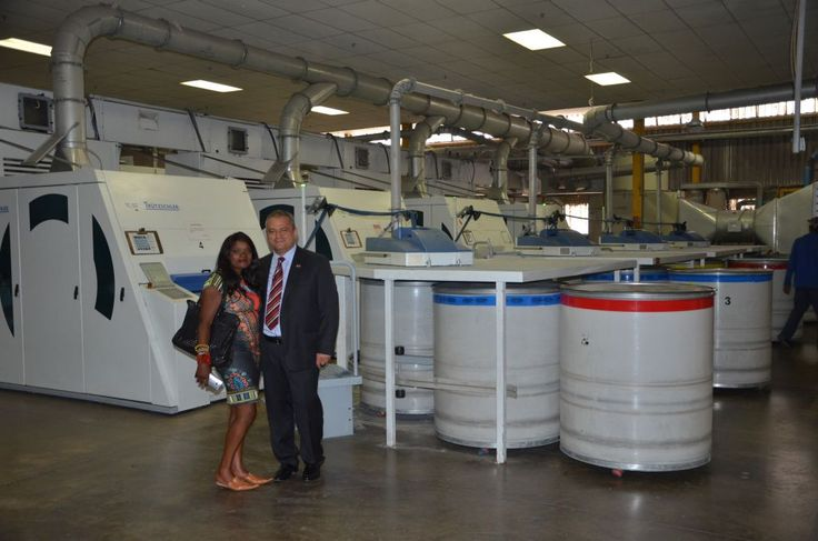 Mr Sesli from Sesli Textiles with Ms Roberts Kaya FM inside the Factory Shop