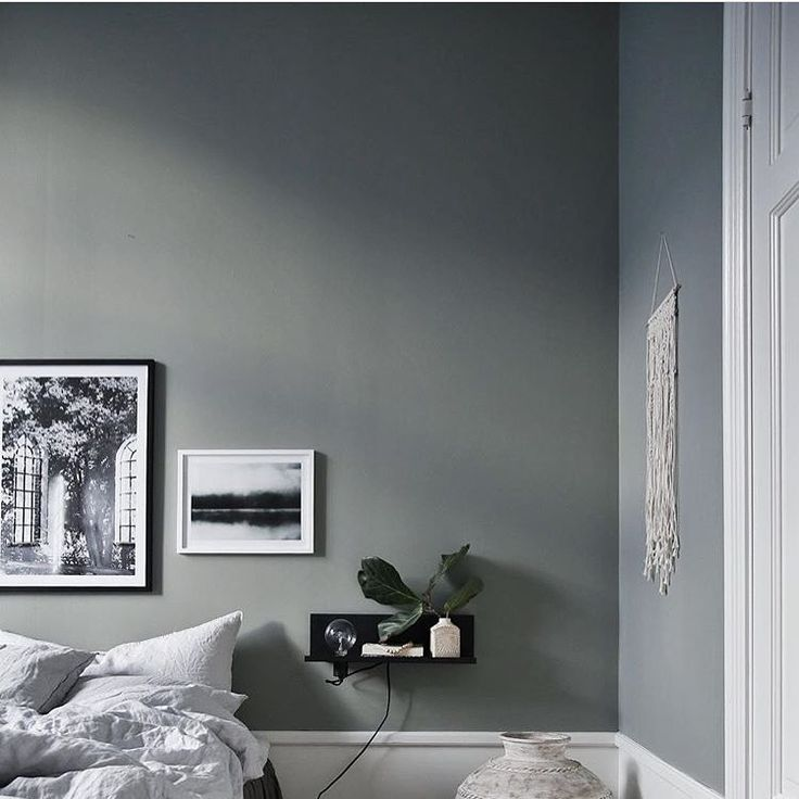 Gorgeous gray wall in minimalistic bedroom from interior designer @JasminaBylund. Framed posters from printler.com, the marketplace for photo art. Motifs by Marianne Brattberg and Jonas Anhede. See more photographs at printler.com