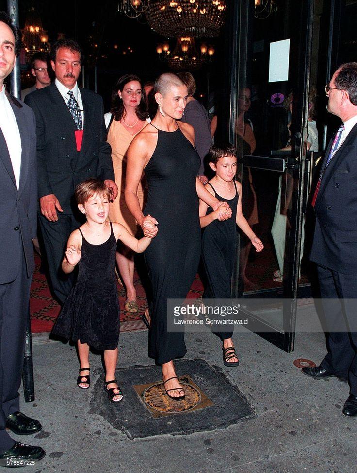 Actress Demi Moore arrives with two of her three daughters, Scout (left) and Rumer, to the Ziegfeld Theater for the premiere of her film, Striptease.