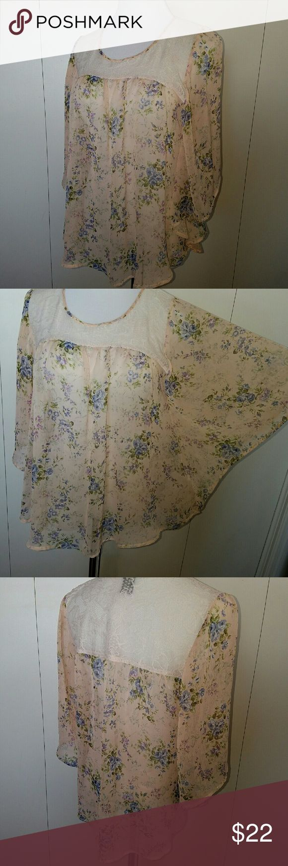 Pale pink floral/lace batwing top Feminine pink and floral batwing blouse  Fabric is sheer and gauzy with lace insert on front and back.  Colors may appear different in person compared to digital screens. Living Doll Tops
