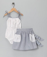 Cute, cozy and positively blossoming with cherries, this sweet bodysuit and pocket skirt set offers any little sweetie super-sweet look. Soft material, adjustable straps, a tie waist and elastic waistbands add to its goodness. Includes bodysuit and skirt100% cottonMachine wash; tumble dry